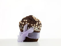 Chocolate muffin wrapped up as a gift Stock Photos