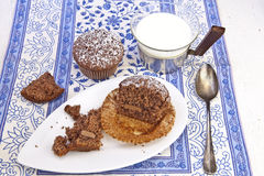 Chocolate Muffins. Freshly baked chocolate muffins sprinkled with powdered sugar Royalty Free Stock Photo