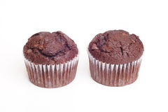 Chocolate Muffins. Photograph of two chocolate muffins shot in studio on a white background Stock Photo