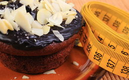 Chocolate muffins with almonds and tape measure Stock Image