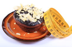 Chocolate muffins with almonds and tape measure Royalty Free Stock Photography