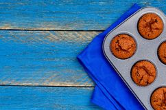 Chocolate muffins on a baking sheet from the oven stock image