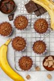 Chocolate muffins with banana and sugar crust on the cooking grill. Fresh homemade pastry stock image