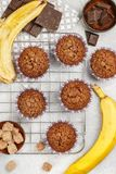Chocolate muffins with banana and sugar crust on the cooking grill. Fresh homemade pastry stock photos