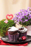 Chocolate muffins and berry drink Stock Photo