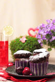Chocolate muffins and berry drink Royalty Free Stock Photo