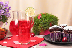 Chocolate muffins and berry drink Stock Photography