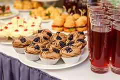 Chocolate muffins on buffet table stock photo