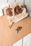 Chocolate muffins with chocolate slices in basket Stock Photos