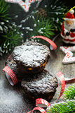 Chocolate muffins with Christmas decorations Stock Images