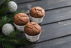 Chocolate muffins,  Christmas tree and Christmas decorations Royalty Free Stock Image
