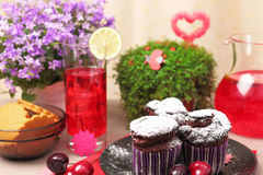 Chocolate muffins and cold berry drink Stock Photography