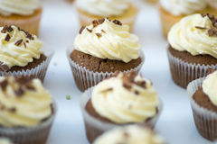 Chocolate muffins with cream. And chocolate flakes stock image