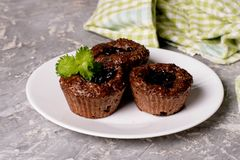 Chocolate muffins with crispy top Stock Photo