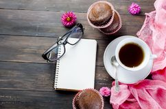 Chocolate muffins and a cup of coffee Royalty Free Stock Images