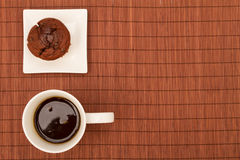 Chocolate Muffins with a cup of coffee Royalty Free Stock Image