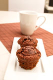 Chocolate Muffins with a cup of coffee Stock Image