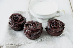 Chocolate muffins decorated with cream Royalty Free Stock Photos