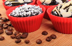 Chocolate muffins with desiccated coconut and almonds, coffee grains Stock Photography