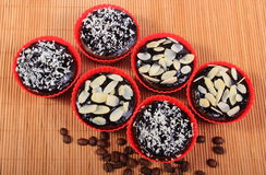 Chocolate muffins with desiccated coconut and almonds, coffee grains Royalty Free Stock Image