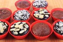 Chocolate muffins with desiccated coconut and almonds Royalty Free Stock Photos
