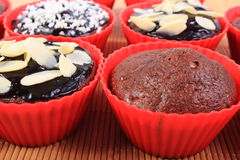 Chocolate muffins with desiccated coconut and almonds Royalty Free Stock Image