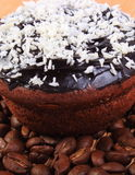 Chocolate muffins with desiccated coconut and coffee grains Stock Photos
