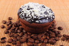 Chocolate muffins with desiccated coconut and coffee grains Royalty Free Stock Photography