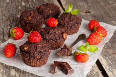 Chocolate muffins and fresh berries. Clode up, horizontal Stock Photos