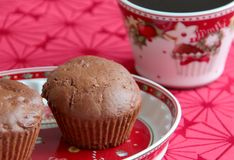 Chocolate muffins with gingerbread spices, plum butter and dark cocoa. Chocolate muffin with gingerbread spices, dark cocoa and pumpkin served on christmas Stock Images