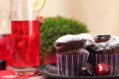 Chocolate muffins and glass of berry drink Royalty Free Stock Images