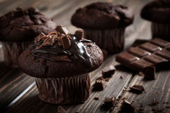 Chocolate muffins with icing and chocolate pieces Stock Images