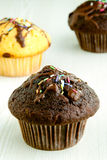 Chocolate muffins on kitchen table Royalty Free Stock Photos