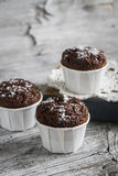 Chocolate muffins on a light wooden surface Royalty Free Stock Photography
