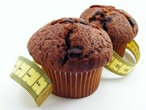 Chocolate muffins & measuring tape Stock Photo