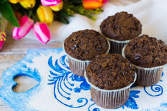 Chocolate muffins on a mother`s day. Chocolate muffins on the board written under gzhel Royalty Free Stock Photography