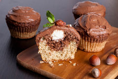 Chocolate muffins with nuts and cottage cheese. Horizontal, close up Royalty Free Stock Image