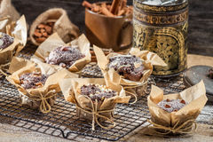 Chocolate muffins with nuts and icing sugar Royalty Free Stock Image