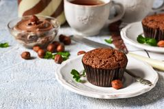 Chocolate muffins with nuts and peanut butter stock image