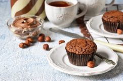 Chocolate muffins with nuts and peanut butter royalty free stock images