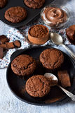 Chocolate muffins with nuts and peanut butter. On a concrete background Royalty Free Stock Photography