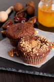 Chocolate muffins with nuts, vertical, close up. Chocolate muffins with nuts, vertical Stock Image