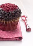 Chocolate muffins with red sugar decoration stock photography