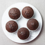 Chocolate muffins on the round plate Stock Photos
