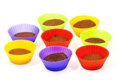 Chocolate muffins in silicone holders of many colors Royalty Free Stock Photos