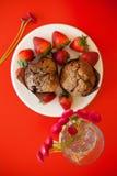 Chocolate muffins with strawberries Stock Photo