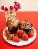 Chocolate muffins with strawberries Stock Photography