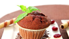 Chocolate muffins, two cupcakes. Fresh baked delicious muffins with chocolate, cupcake, close up, dolly shot stock footage