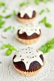 Chocolate muffins with vanilla frosting Royalty Free Stock Image