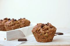 Chocolate muffins on the white and pink background stock image